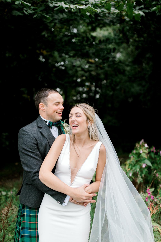Bride Bridal Deep V Plunge Neckline Dress Sleeveless Slim Fit Ogilvie Tartan Kilt Groom Veil Tin Shed Knockraich Farm Wedding The Gibsons Photography