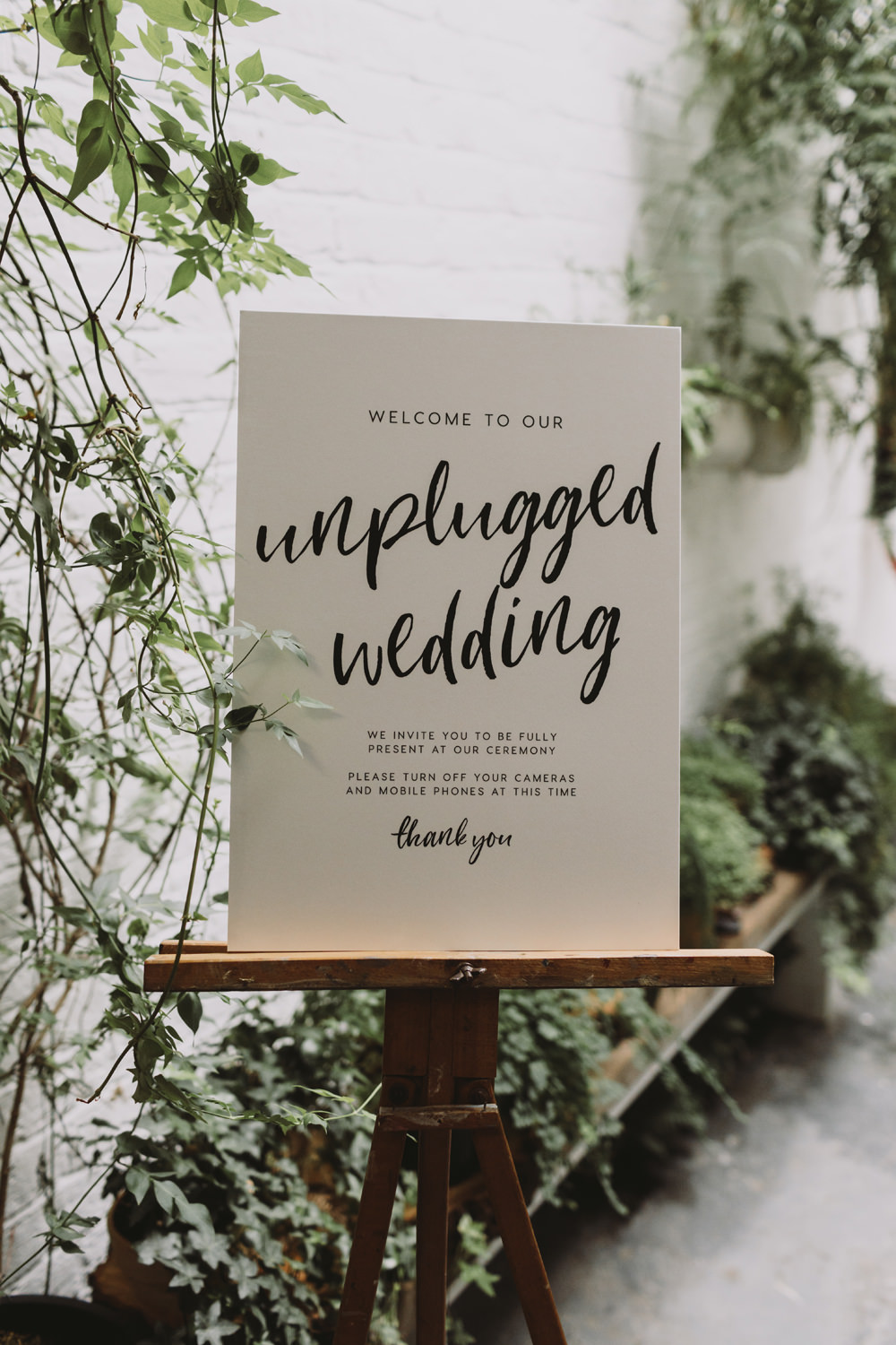 Unplugged Wedding Sign Modern Calligraphy Wooden Easel Greenery Foliage Tram House Wedding Luke Hayden Photography