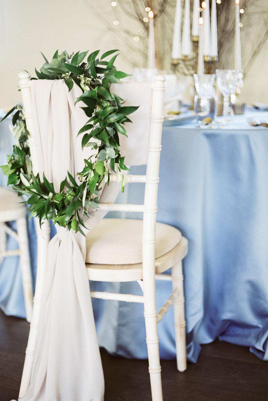 Greenery Foliage Wreath Hoop Chairs Fabric Winter Blue Barn Wedding Ideas Joanna Briggs Photography
