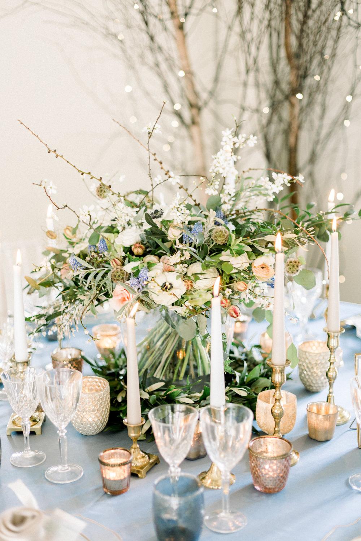 Table Flowers Centrepiece Candles Grape Hyacinth Anemone Greenery Folliage Nigella Seeds Scabious Blossom Winter Blue Barn Wedding Ideas Joanna Briggs Photography