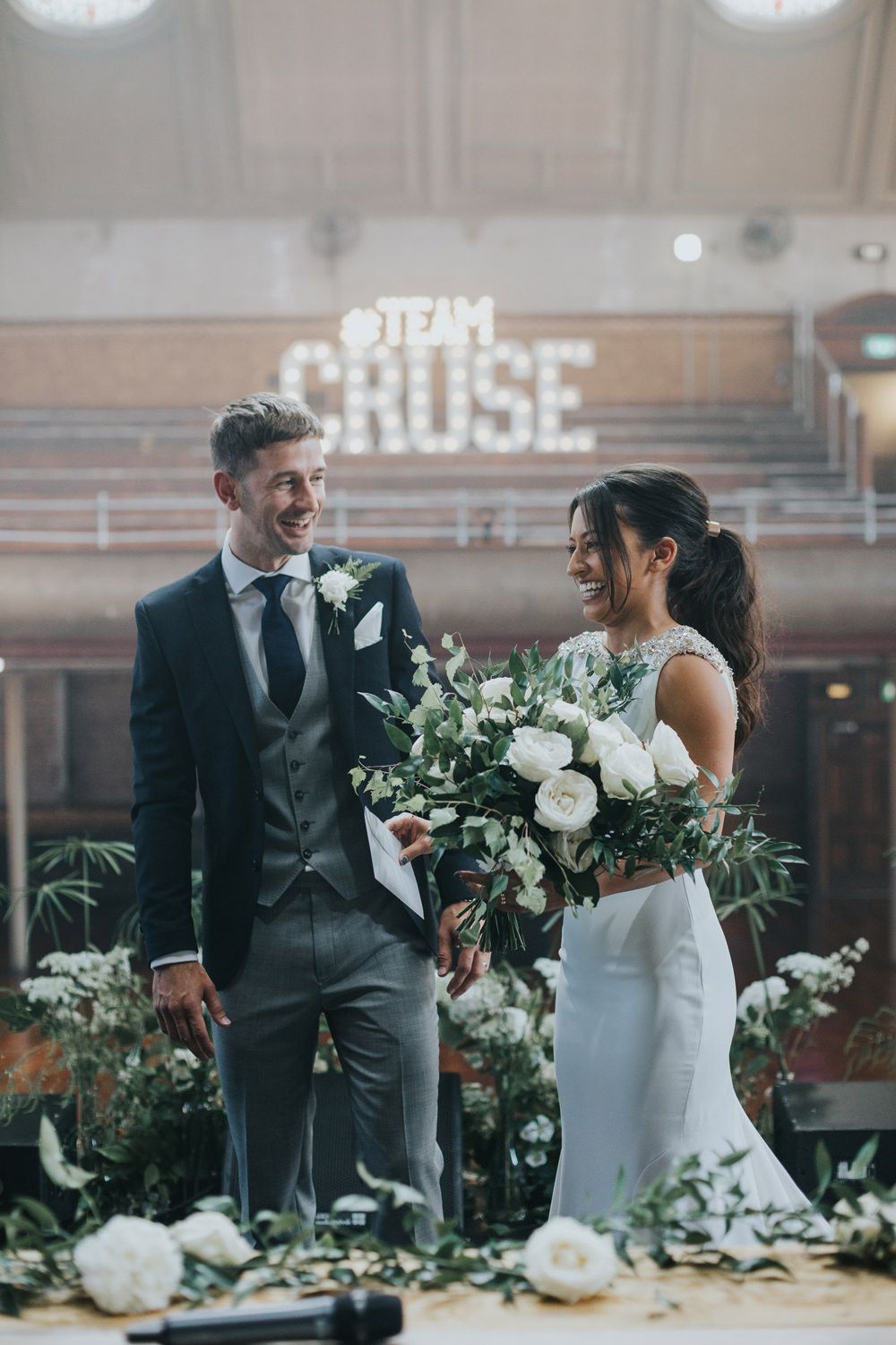 Pronovias Dress Gown Fit and Flare Embellished Sparkle Long Train Mismatched Suit Groom White Flowers Floral Greenery Bouquet Albert Hall Manchester Wedding Katie Dervin Photography