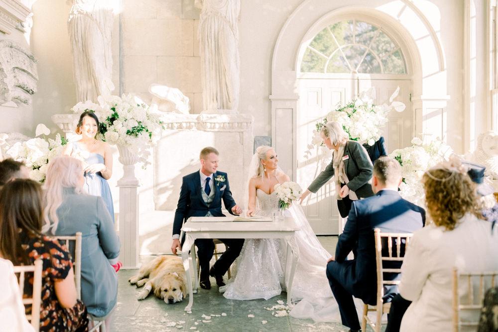 Bride Bridal Berta Princess Sparkly Dress Gown Veil Navy Tailcoat Groom Dog Ceremony Registrar table Aynhoe Park Wedding Sanshine Photography