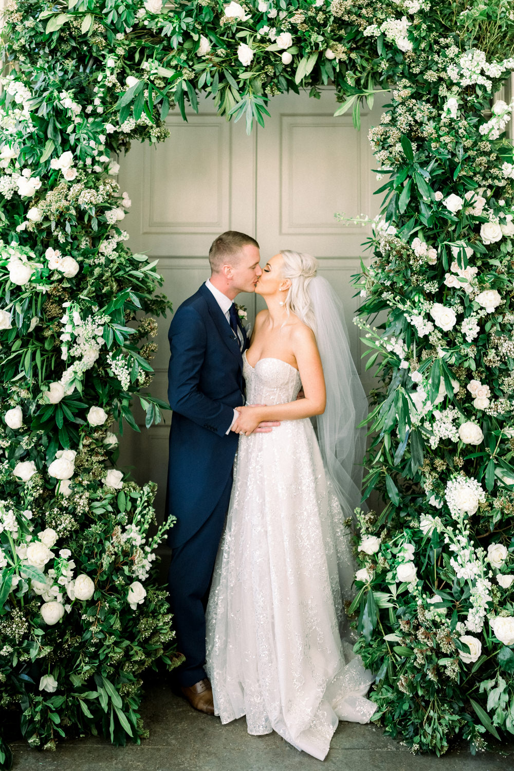 Bride Bridal Berta Princess Sparkly Dress Gown Veil Navy Tailcoat Groom Sweetheart Floral Arch Aynhoe Park Wedding Sanshine Photography