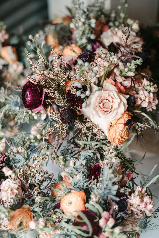 Bride Bridal Bouquet Flowers Ribbon Pink Orange Red Rose Ranunculus Fantasy Nerdy Wedding Eric Lundgren Photography
