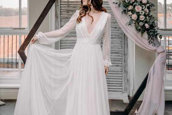 Hexagon Backdrop Flowers Installation Moongate Arch Bride Bridal Dress Gown Kula Tsurdiu Tulle Long Sleeves Train Free Spirited Wedding Ideas EKR Pictures