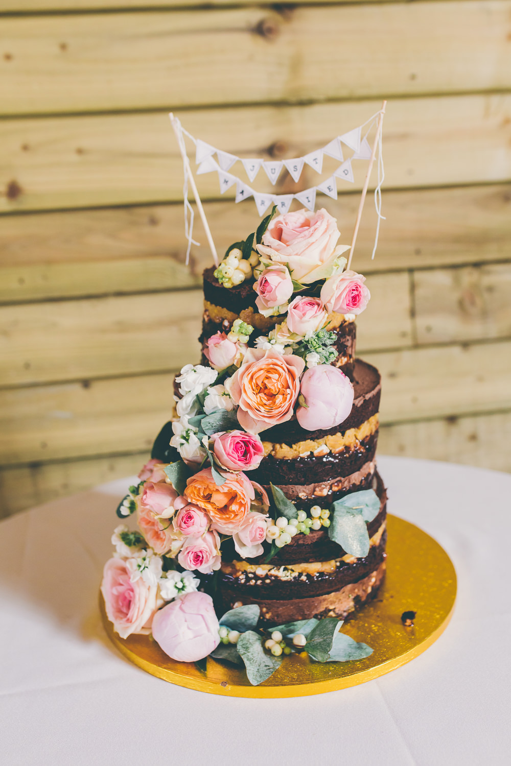 Naked Cake Chocolate Sponge Layer Flowers Floral Bunting Topper High Billinghurst Farm Wedding Larissa Joice Photography