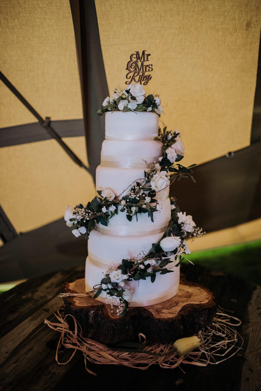 Iced Cake Greenery Foliage Log Slice Stand Hirst Priory Wedding Kazooieloki Photography