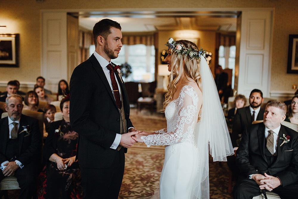 Bride Bridal Sweetheart Neckline Lace Long Sleeve Flower Crown Three Piece Suit Tweed Waistcoat Groom Inn on the Lake Wedding Leah Lombardi Weddings