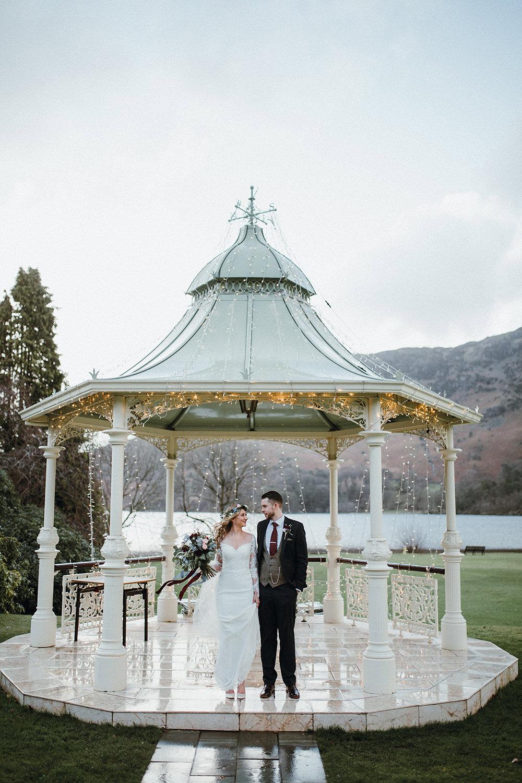Bride Bridal Sweetheart Neckline Lace Long Sleeve Flower Crown Three Piece Suit Tweed Waistcoat Groom Fairy Light BandstandInn on the Lake Wedding Leah Lombardi Weddings
