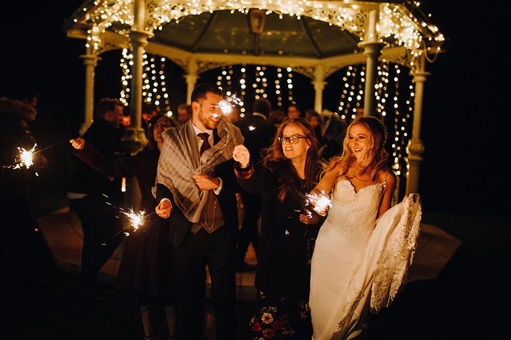 Bride Bridal Sweetheart Neckline Lace Long Sleeve Flower Crown Three Piece Suit Tweed Waistcoat Groom Sparklers Inn on the Lake Wedding Leah Lombardi Weddings