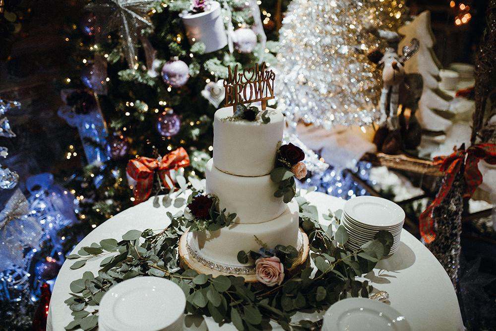White Tiered Cake Wooden Topper Eucalyptus Inn on the Lake Wedding Leah Lombardi Weddings