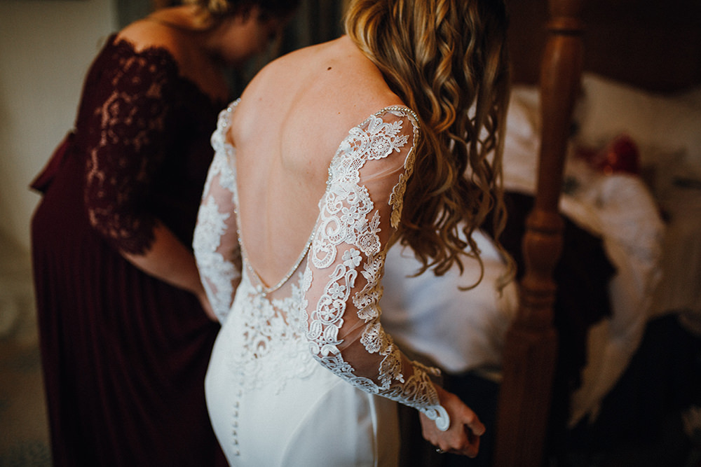 Bride Bridal Backless Lace Button Back Dress Gown Long Sleeves Inn on the Lake Wedding Leah Lombardi Weddings
