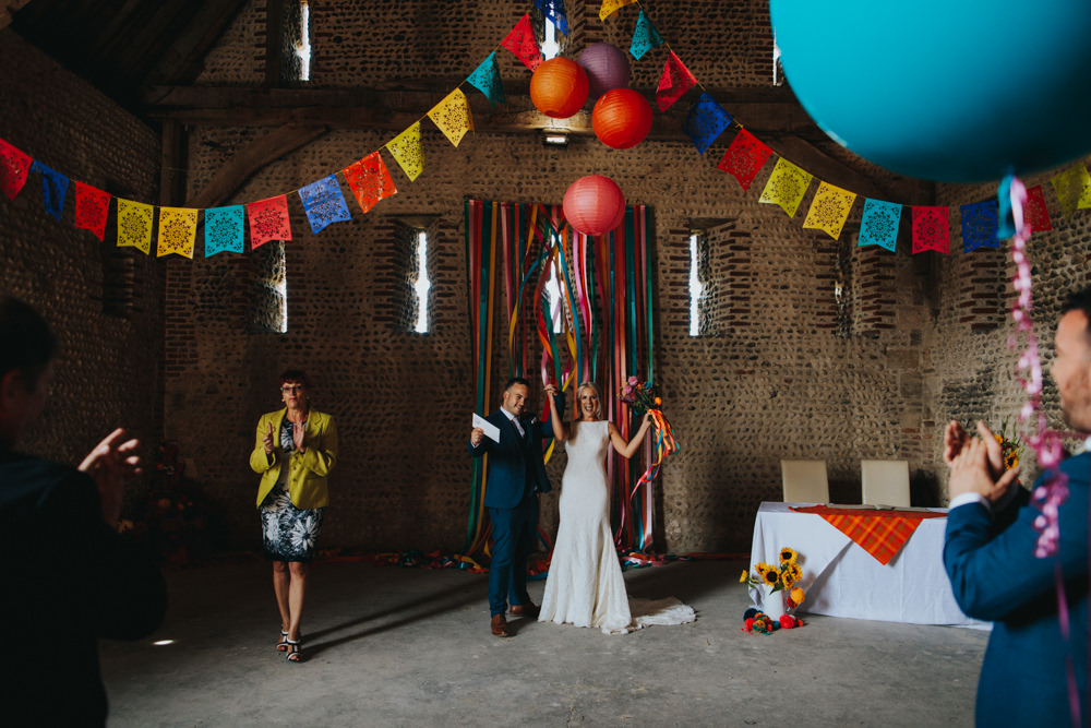 Bride Bridal Pronovias Dress Gown Boat Neck Fitted Navy Suit Groom Mexican Multicoloured Decor Waxham Great Barn Wedding Joshua Patrick Photography