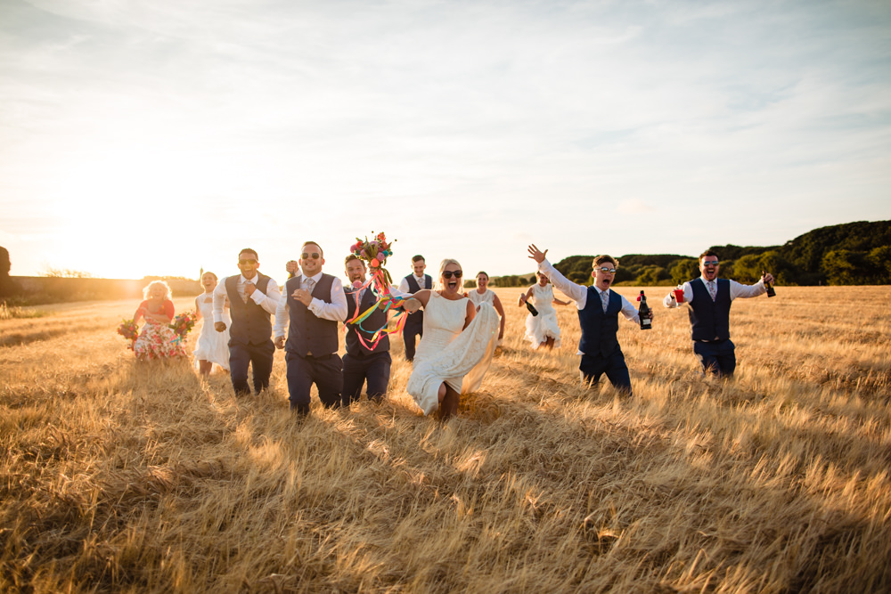 Golden Hour Field Wedding Party Running Waxham Great Barn Wedding Joshua Patrick Photography