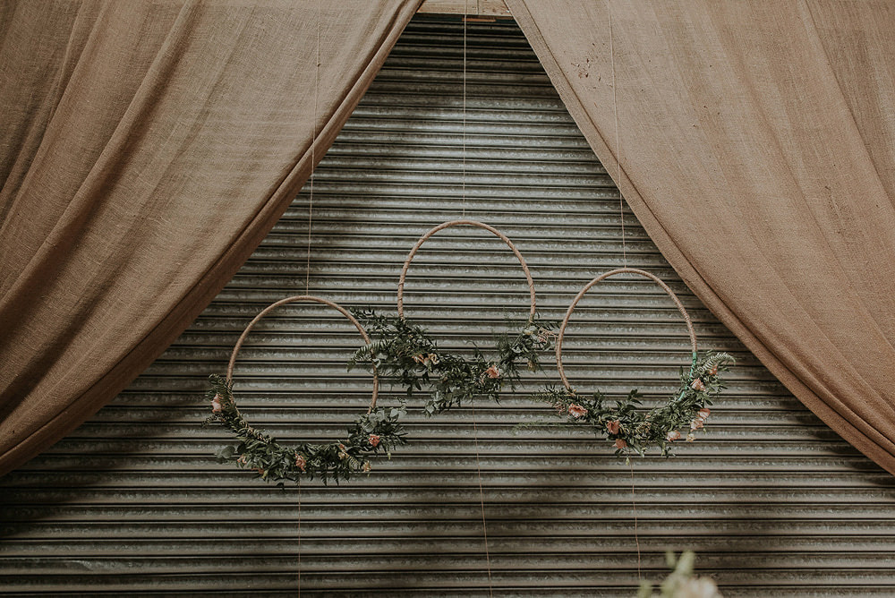 Hanging Hoops Wreaths Foliage Decor Decoration Backdrop Captains Wood Barn Wedding Megan Elle Photography