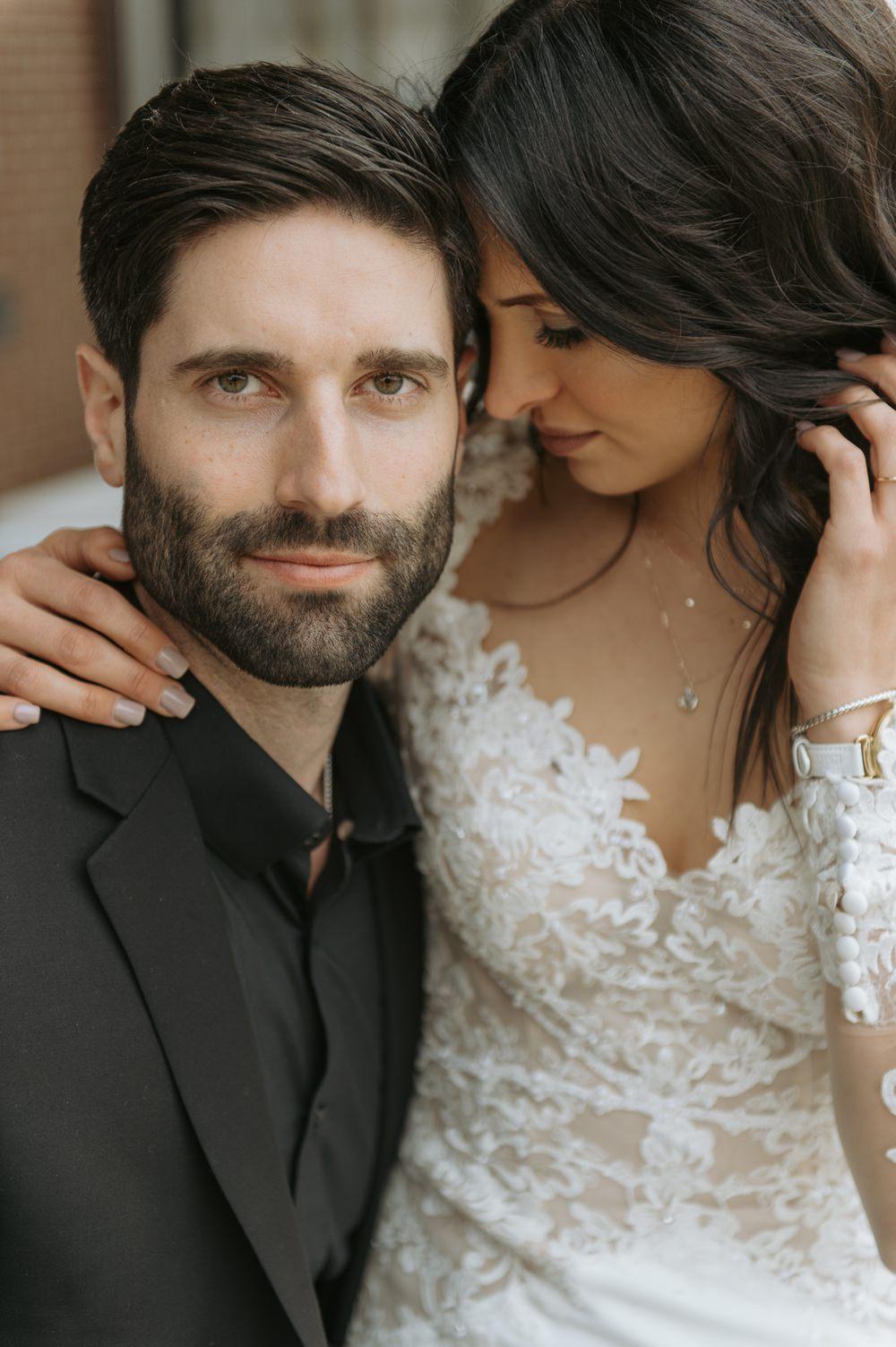 Groom Black Suit Tie Shirt Open Collar Greenhouse Michigan Wedding Jean Smith Photography