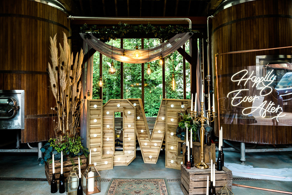 Decor Decoration Backdrop Ceremony Fetoon Lights Edison Lightbulbs Flower Arch Pampas Grass Crates Candles LOVE Letters Neon Sign Signage Signs Indie Wedding Ideas Kat Antos-Lewis Photography
