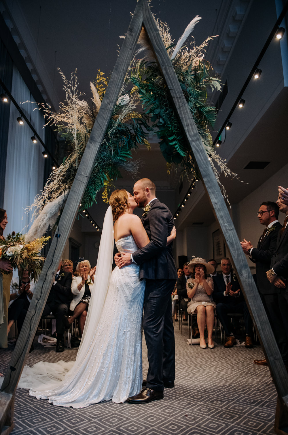 Bride Bridal Strapless Sequin Embellished Dress Gown Train Veil Navy Suit Groom Wildflower Bouquet Triangle Arbour Foliage Manchester Wedding Kazooieloki Photography
