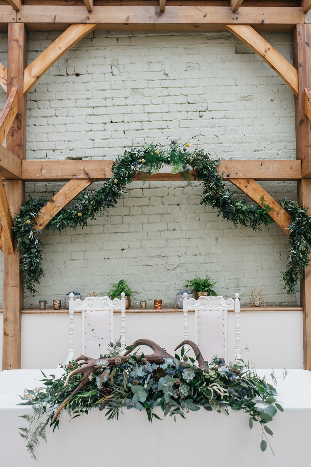 Top Table Greenery Foliage Wreath Antlers Thrones Quirky Rustic Charm Wedding Justin Bailey Photography