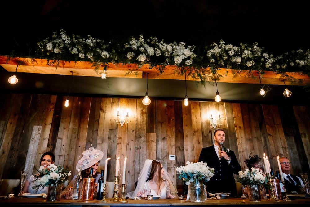 Edison Lighting Light Bulbs Flowers Greenery Foliage Decor Tables Wharfedale Grange Wedding Hayley Baxter Photography