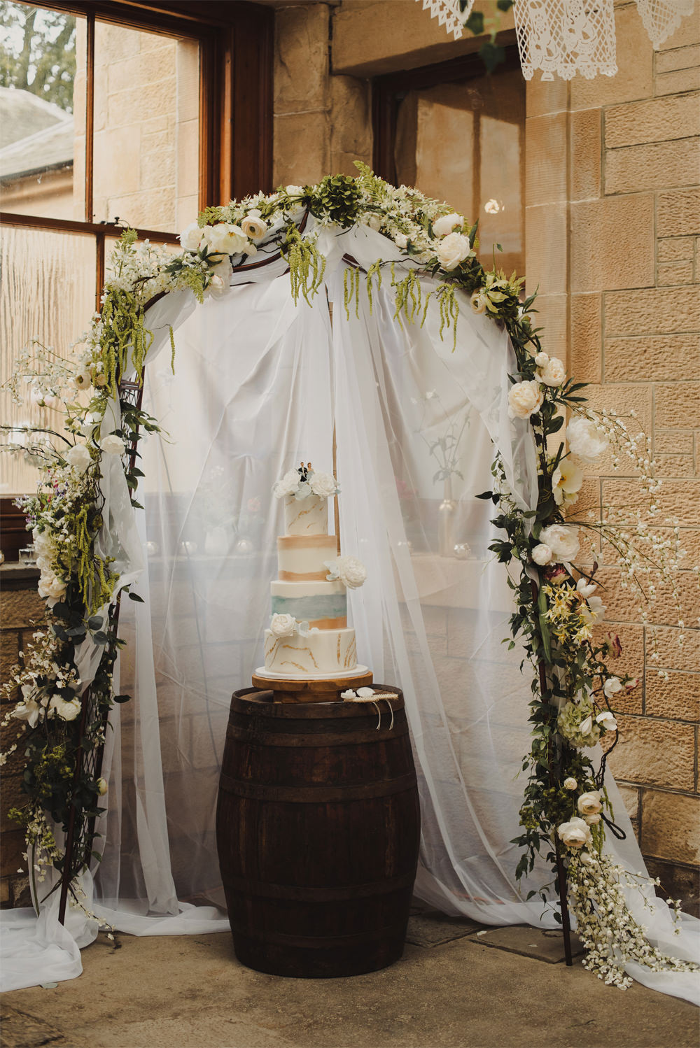 Flower Arch Greenery Foliage Fabric Cake Table Cambo Estate Wedding Anna Urban Wedding Photography