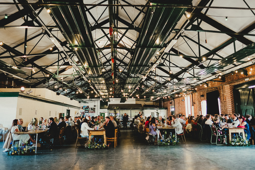 Warehouse Venue Festoon Lights Long Tables School Chairs Elsecar Heritage Centre Wedding Ayesha Photography
