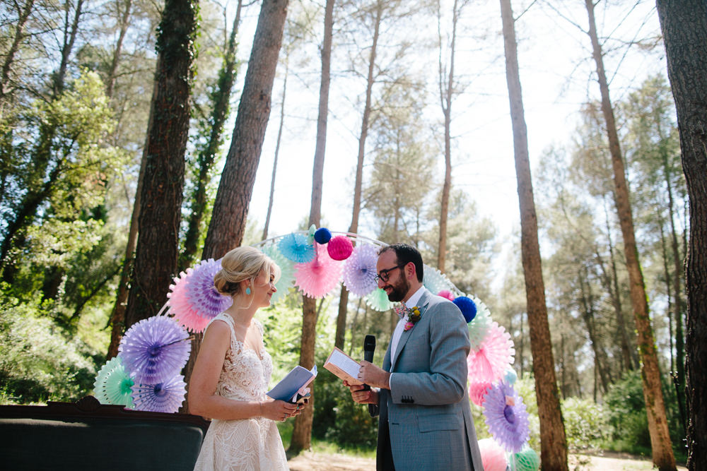 Bride Bridal Lace Strappy Sleeveless Embellished Dress Gown Mismatched Bow Tie Groom Pin Wheel Paper Lantern Arch Purple Pink Colourful Forest Spain Destination Wedding Dan Hough Photography