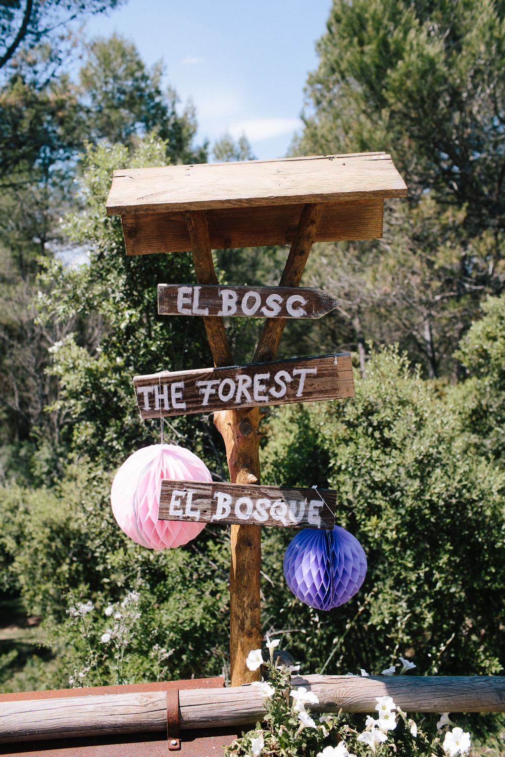 Wooden Sign Post Direction Paper Lantern Forest Spain Destination Wedding Dan Hough Photography