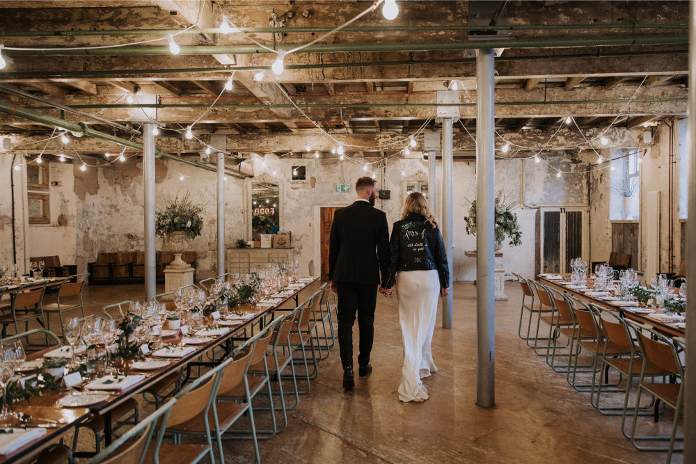 Industrial Decor Reception Long Tables Wooden Festoon Lights Greenery Foliage Chairs Holmes Mill Wedding Siobhan Amy Photography