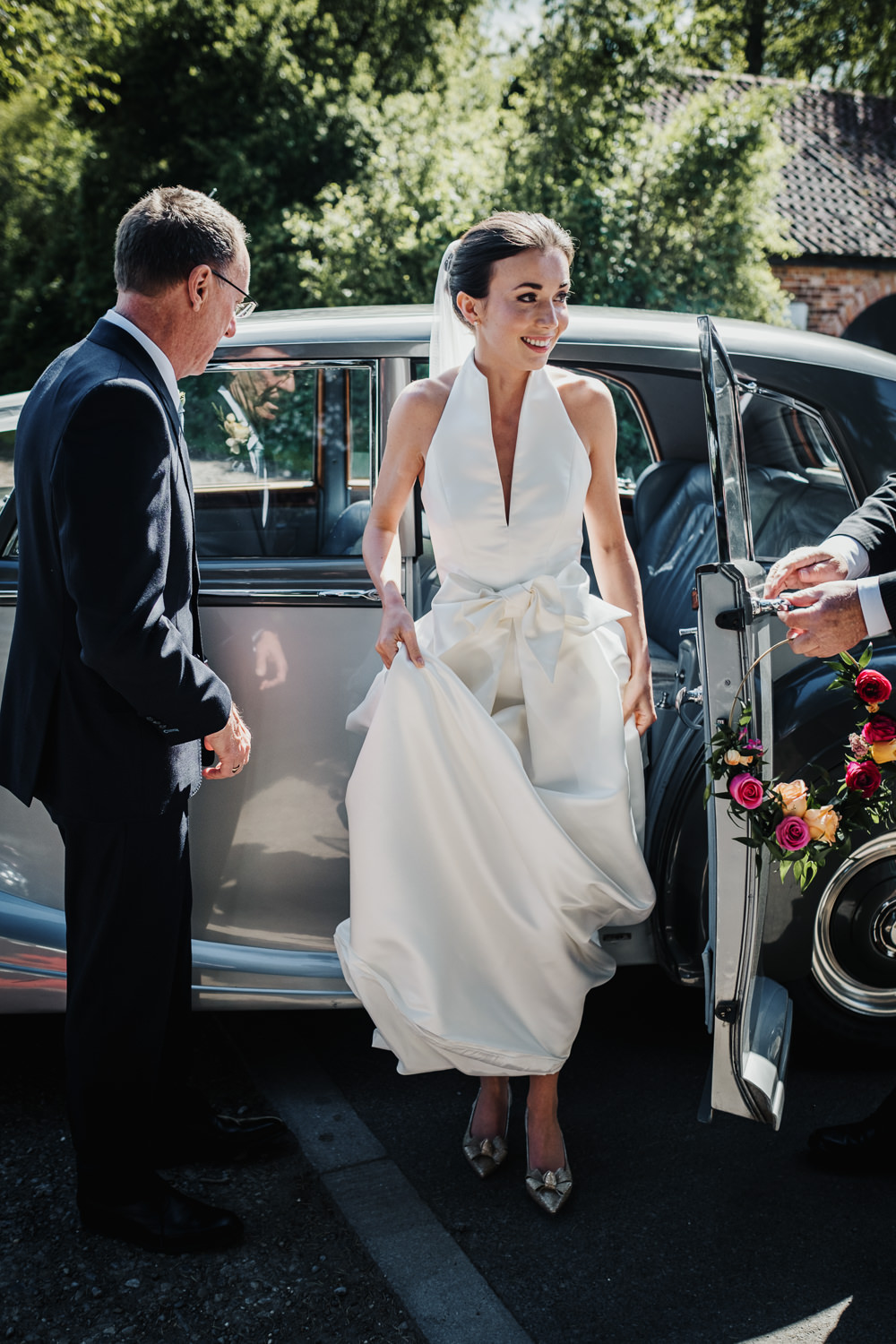 Bride Bridal Halterneck Collar Dress Gown Pockets Bow Jesus Peiro Middlethorpe Hall Wedding Andy Withey Photography
