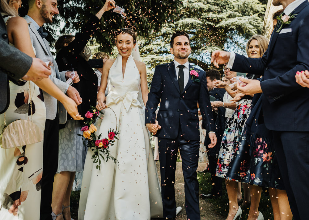 Bride Bridal Halterneck Collar Dress Gown Pockets Bow Jesus Peiro Navy Suit Groom Floral Hoop Confetti Middlethorpe Hall Wedding Andy Withey Photography