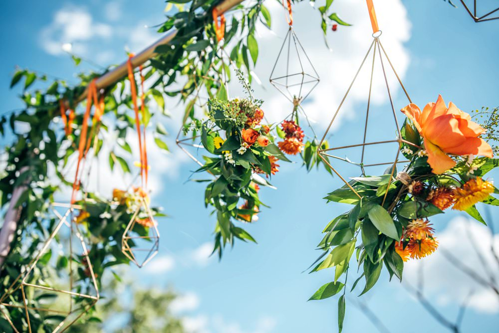 Ceremony Aisle Frame Arch Backdrop Greenery Foliage Flowers Terrarium Orange Roses Outdoor DIY Wedding Three Flowers Photography