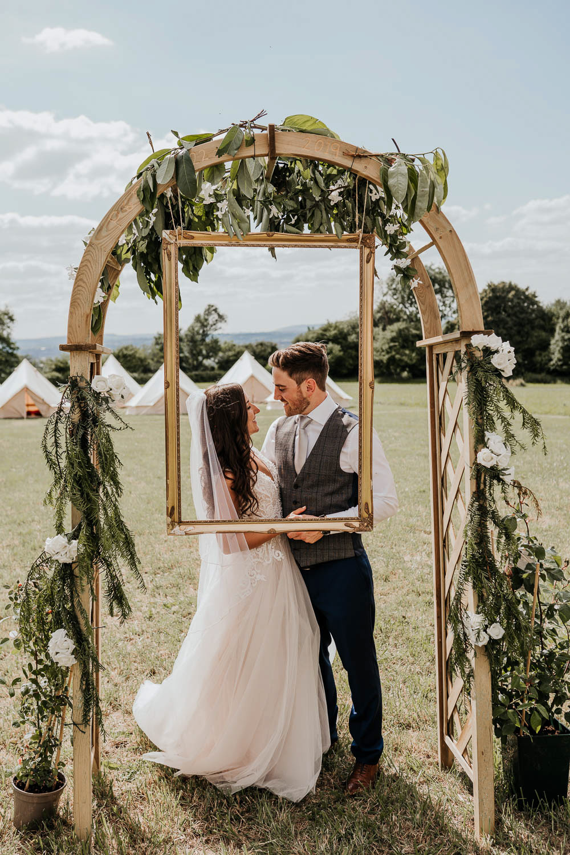 Arch Greenery Foliage Frame Photo Booth Village Tipi Wedding Ryan Goold Photography