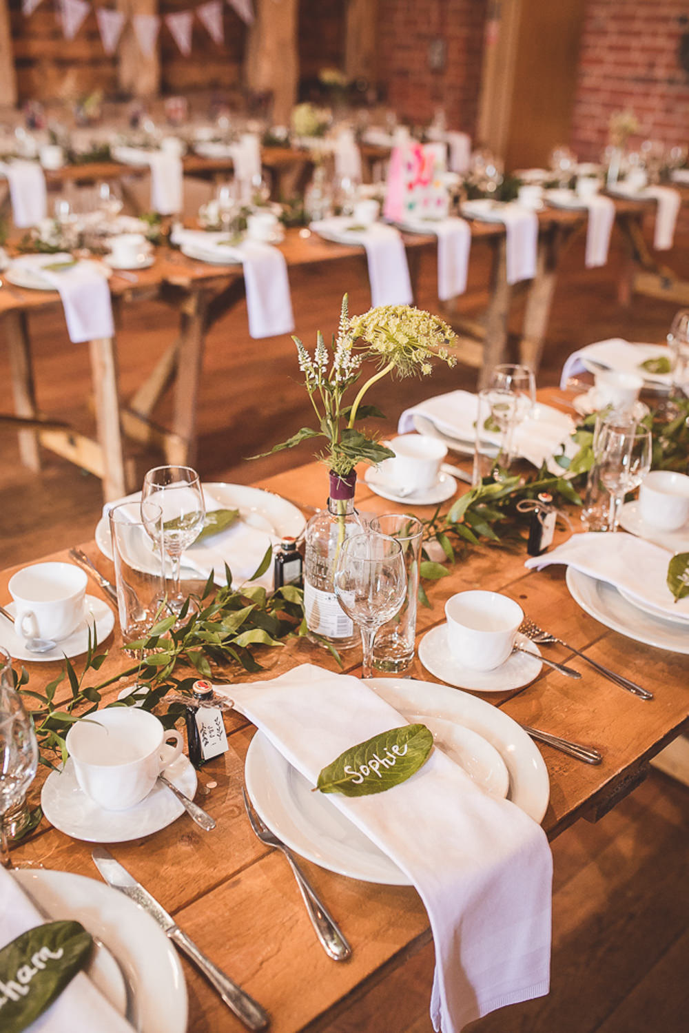 Centrepiece Decor Flowers Bottle Greenery Foliage Barn Wedding Shropshire Brightwing Photography