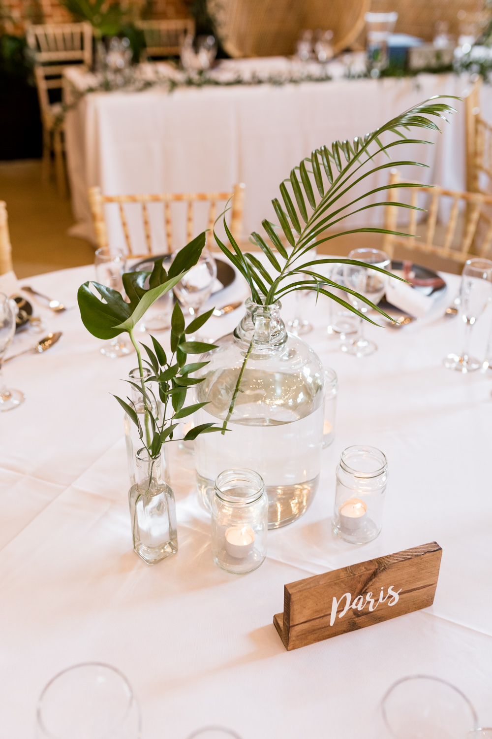 Table Centre Leaf Tropical Glass Bottle Botanical Barn Wedding Heather Jackson Photography