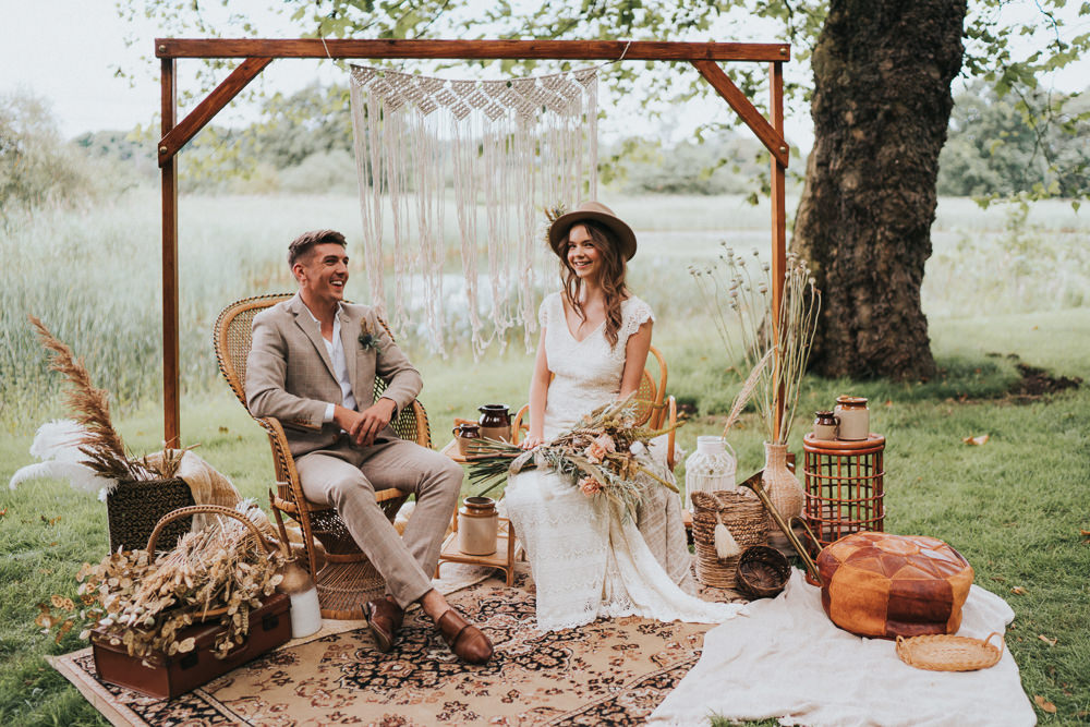 Peacock Chair Macrame Decor Backdrop Frame Pampas Grass Persian Rug Naked Tipi Wedding Ideas Holly Rose Stones