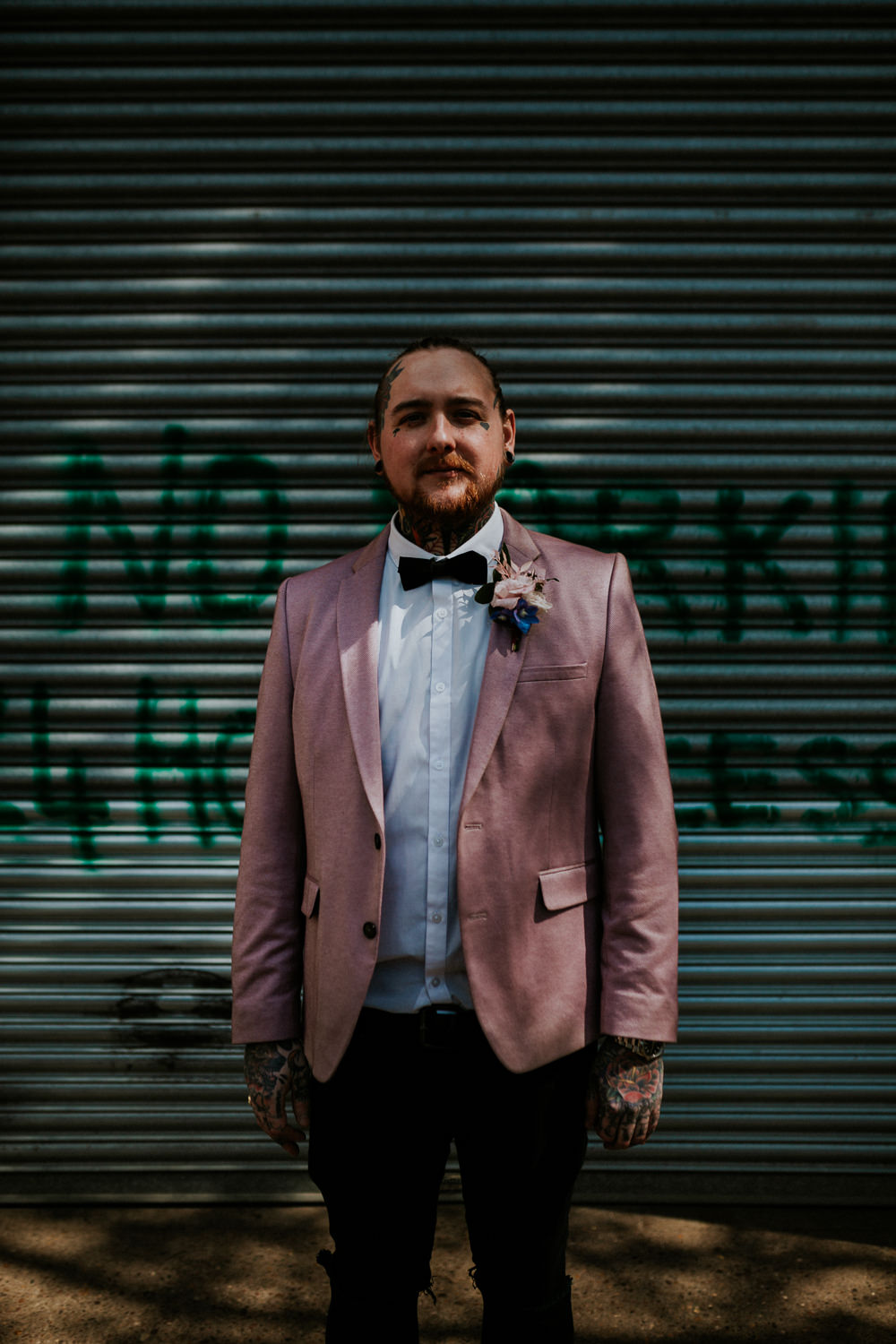 Groom Suit Pink Blazer Jacket Bow Tie Neon Sign Wedding Ideas State Of Love and Trust Photography