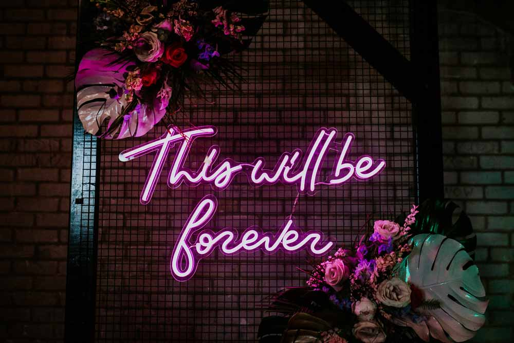 Backdrop Arch Flowers Neon Sign Wedding Ideas State Of Love and Trust Photography