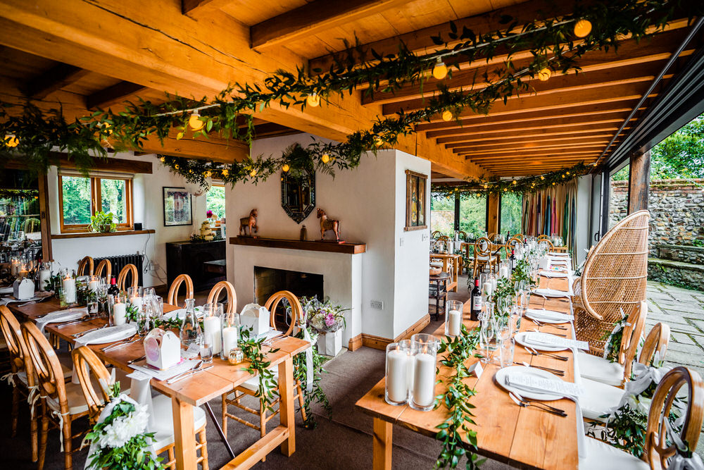 Wooden Tables Greenery Foliafe Runner Swag Centrepiece Candles Secret Garden Wedding James Powell Photography