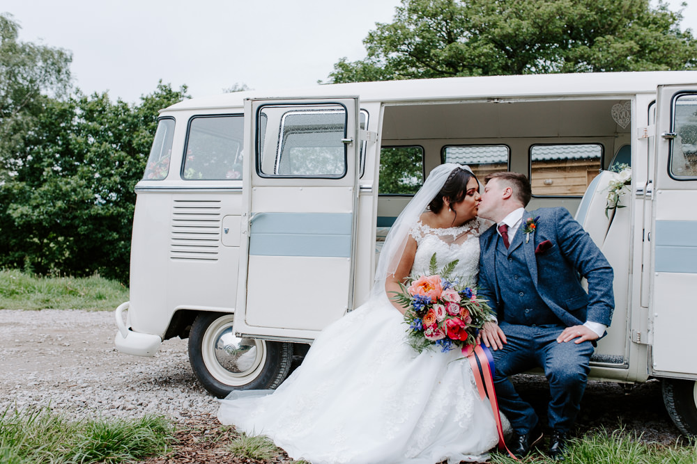 Bride Bridal Lace Dress Gown Sweetheart Neckline Boat Neck Blue Tweed Three Piece Suit Waistcoat Suit Groom Veil Bouquet VW Campervan Tipis Riley Green Wedding Jessica Isherwood Photography
