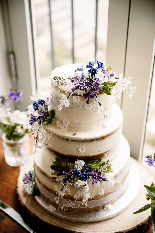 Semi Naked Cake Buttercream Flowers Purple White Yorkshire Barn Wedding Hayley Baxter Photography