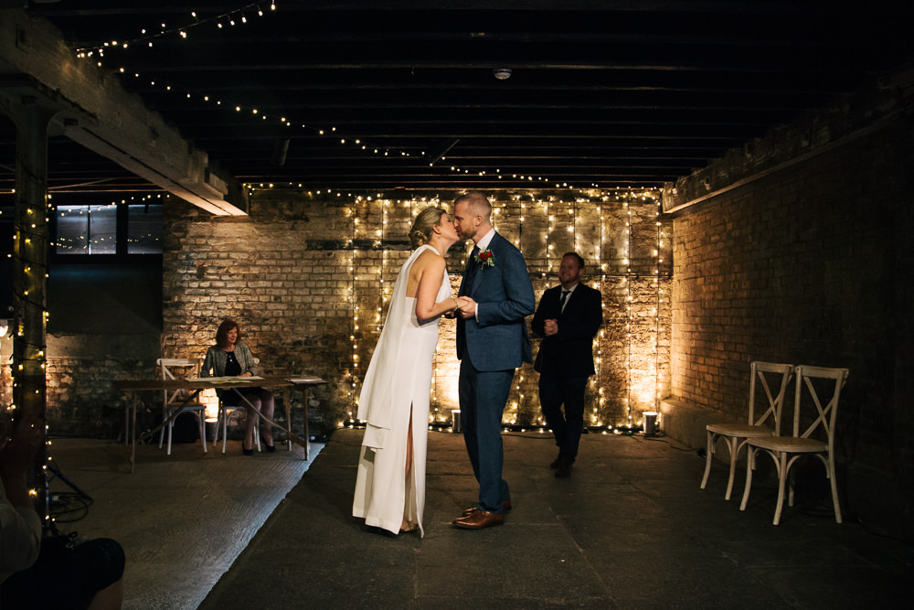 Electrician's Shop Trinity Buoy Wharf Ceremony Fairy Lights Bridal Jumpsuit Wedding Emily Jarrett Photography