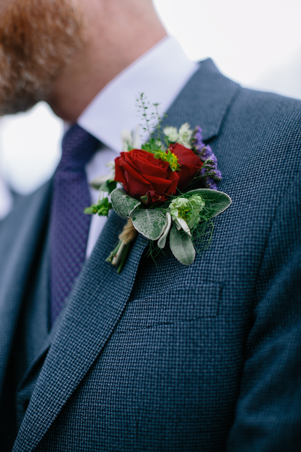 Groom Suit Navy Blue Purple Tie Rose Buttonhole Bridal Jumpsuit Wedding Emily Jarrett Photography