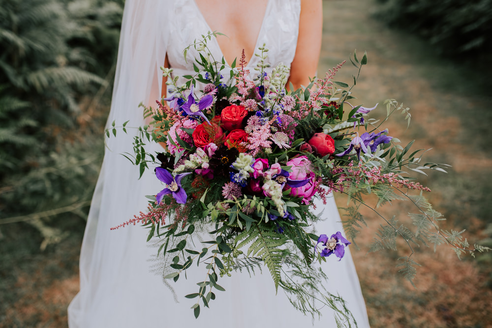 Bouquet Flowers Bride Bridal Pink Astilbe Dahlia Purple Greenery Foliage Clematis Rose Butley Priory Wedding Sally Rawlins Photography