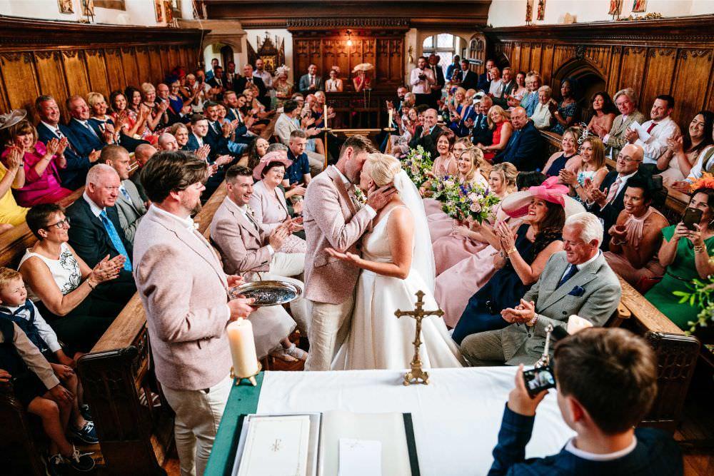 Bride Bridal V Neck Justin Alexander Dress Gown A Line Pink Salmon Custom Suit Groom Church Carousel Wedding Sarah Legge Photography