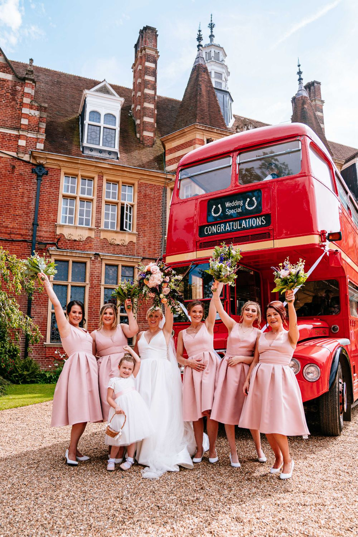 Bride Bridal V Neck Justin Alexander Dress Gown A Line Pink Bridesmaids Bouquets Red Vintage Routemaster Bus Carousel Wedding Sarah Legge Photography