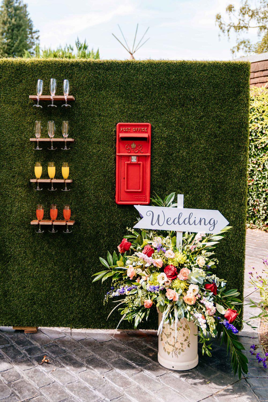 Champagne Wall Post Box Milk Churn Florals Direction Sign Carousel Wedding Sarah Legge Photography