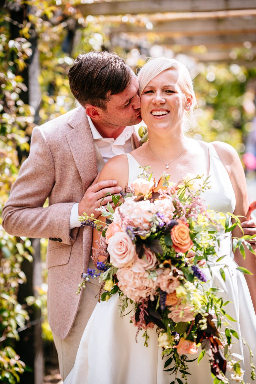 Bride Bridal V Neck Justin Alexander Dress Gown A Line Pink Salmon Custom Suit Groom Carousel Wedding Sarah Legge Photography