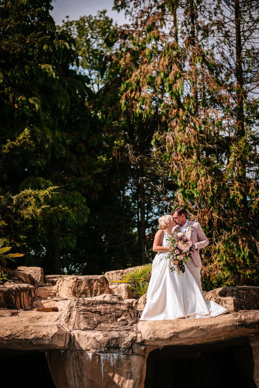 Bride Bridal V Neck Justin Alexander Dress Gown A Line Pink Salmon Custom Suit Groom Trailing Bouquet Carousel Wedding Sarah Legge Photography