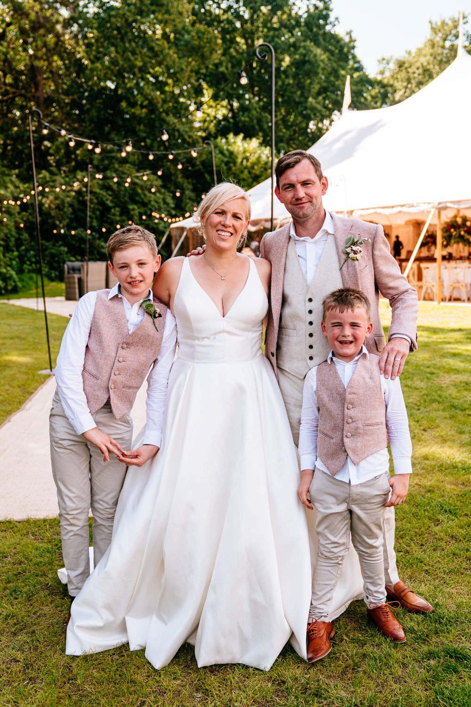 Bride Bridal V Neck Justin Alexander Dress Gown A Line Pink Salmon Custom Suit Groom Page Boys Matching Waistcoats Carousel Wedding Sarah Legge Photography